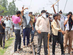 BJP workers clashed with police at several places since Friday morning and also stopped two trains — Upasana Express and a goods train.