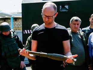 Arseny Yatseniuk , blaming Russia, says experts, not .drunken ...