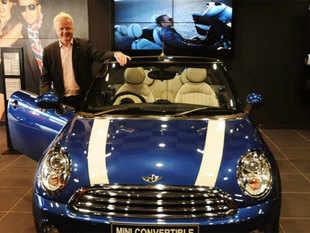 President BMW Group, India Philipp von Sahr poses with the new BMW Mini Convertible