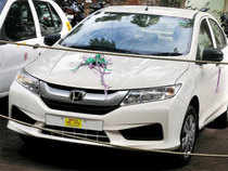 Honda Motor has started work on developing a small car and a compact SUV targeting India, as it aims to break into the country's mass market segment.
