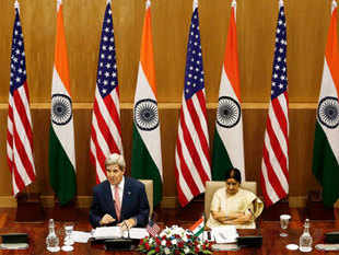 US Secretary of State John Kerry addresses the media as External Affairs Minister Sushma Swaraj (R) looks on during their joint news conference New Delhi July 31, 2014.