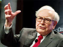 Warren Buffett will help finance Burger King's planned takeover of the Canadian coffee and donut chain Tim Hortons.