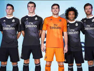 Real Madrid's players Colombian James Rodriguez (L-R), Welsh Gareth Bale, Spanish goalkeeper Iker Casillas, Brazilian Marcelo and Spanish Xavi Alonso pose wearing the team's new outfit for the UEFA Champions League during its presentation held at the Santiago Bernabeu stadium in Madrid, Spain, 26 August 2014. Pic Credit: EPA