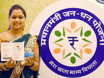 woman displaying pass book and Rupay card of her bank account opened under the Pradhan Mantri Jan Dhan Yojana in Mumbai on Thursday