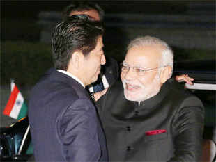 Modi being greeted by Shinzo Abe upon arrival in Kyoto.