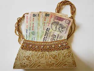 Savings in deposits by the households rose, however, to Rs 1 trillion (17 per cent) in the year to Rs 6.91 trillion in FY14 as against Rs 5.91 trillion in 2012-13.