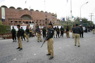 Pakistan policemen stand guard outside the Gaddafi stadium. More Pictures
