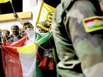 """""""Raising flags is an important factor in the battle,"""" a peshmerga colonel said. """"The flag is the foundation of victory."""""""