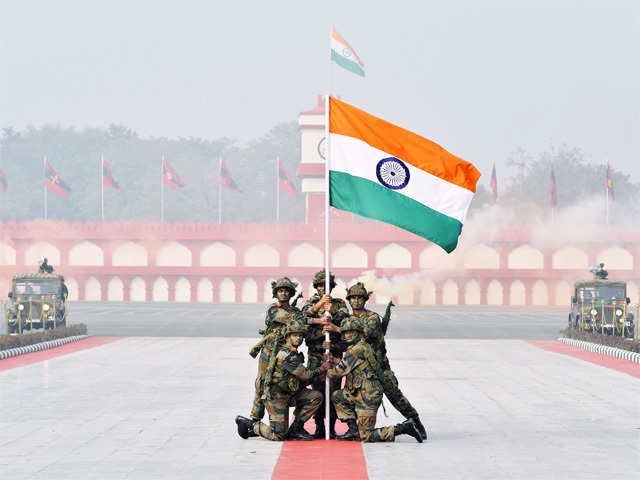 Indian soldiers hold up their national flag on Army day - India ...