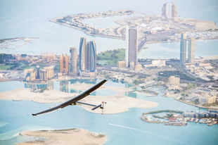 A handout picture released by the Solar Impulse project shows the solar-powered plane Solar Impulse 2 flying over the Emirati capital Abu Dhabi on February 26, 2015. (AFP photo)