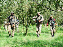 In pic: Army personnel takes position during a gunfight with militants in Pulwama district in South Kashmir on Tuesday 11 August 2015.