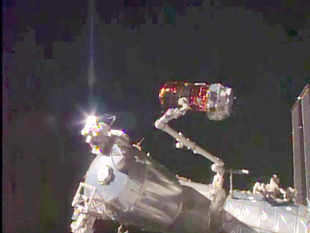 Japan Aerospace Exploration Agency (JAXA) Kounotori 5 H-II Transfer Vehicle (HTV-5) on the Canadarm as it prepares to dock with the International Space Station. Kounotori was bolted into place on the International Space Station's Earth-facing port of the Harmony module at 10:02 a.m. EDT. The HTV-5 is delivering more than 8,000 pounds of equipment, supplies and experiments in a pressurized cargo compartment. The unpressurized compartment will deliver the 1,400-pound CALorimetric Electron Telescope (CALET) investigation, an astrophysics mission that will search for signatures of dark matter and provide the highest energy direct measurements of the cosmic ray electron spectrum.