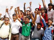 Hardik Patel, a popular leader of Patidar farming caste group, shout slogans.