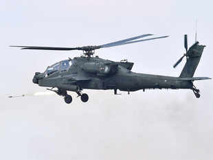 A US AH-64 Apache helicopter fires rockets during a joint live firing drill between South Korea and the US.