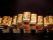 Bullion vaulted over 1% higher to an intraday high of $1,180 per ounce in early New York trading immediately after China announced a surprise rate cut.