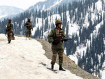 Army soldiers stand guard near to where an encounter took place in the Tanghdar sector north of Kashmir's Kupwara district on November 25, 2015.