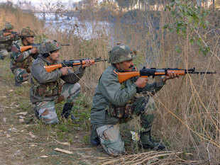 In pic: Soldiers take up position on the perimeter of an airforce base in Pathankot during an operation to 'sanitise' the base following an attack by gunmen.