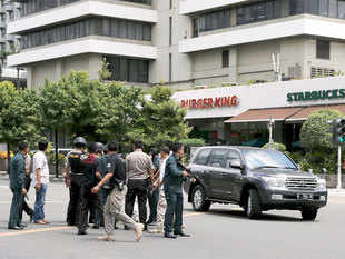 At least three suicide bombers exploded themselves in a Starbucks cafe in downtown Jakarta on Thursday while two gunmen attacked a police post nearby.