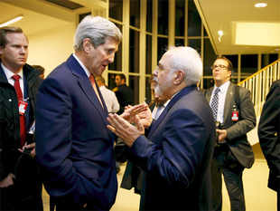 US Secretary of State John Kerry talks with Iranian Foreign Minister Mohammad Javad Zarif after the IAEA verified that Iran has met all conditions under the nuclear deal, in Vienna.
