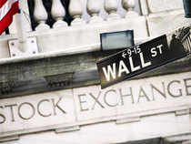 Wall Street rose on Tuesday morning after China's slowest annual growth rate in 25 years raised hopes of further stimulus measures from Beijing.