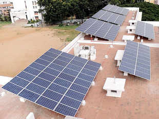 Foreign firms have bid record low solar power tariffs of Rs 4.34 per unit in the latest auction, making green energy even more competitive.