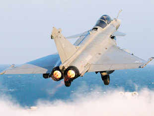 A Rafale fighter jet is catapulted for a mission, on France's flagship Charles de Gaulle aircraft carrier in the Persian Gulf.