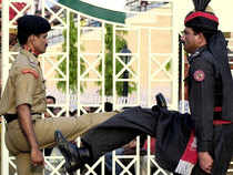 A Pakistani paramilitary trooper and his Indian counterpart parade in opposite directions during the routine flag lowering ceremony at the eastern Wagah border.