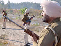 In pic: Police personnel stand alert near the airforce base in Pathankot on January 5, 2016.