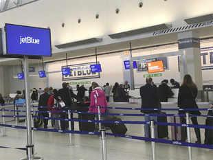 Where do international flights arrive at JFK International Airport?