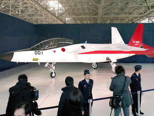 Japan today unveiled its first stealth fighter jet, officials said, with the maiden test flight planned for next month.