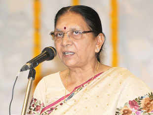 Business associates of Anar Patel, daughter of Gujarat CM Anandiben Patel, own a company that's sitting on 400 acres of land near the Gir lion sanctuary in the state .