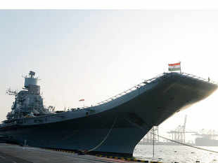 Among the intimidating aircraft carriers and destroyers lined up at the Vizag harbour for the International Fleet Review 2016 is a small patrol craft, distinguished only by the green bands it sports, that might well be the future of the Indian Navy.