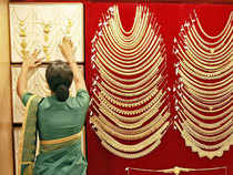 Gold continued its seven-day rising momentum at the domestic bullion market here today due to robust offtake by stockists and retailers in the face of encouraging global cues.