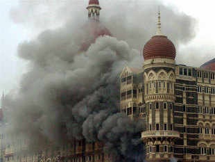 File photo: Smoke is seen billowing out of the ground and first floor of the Taj Hotel in south Mumbai during security personnel's 'Operation Cyclone' following the 26/11 terror attacks in 2008.