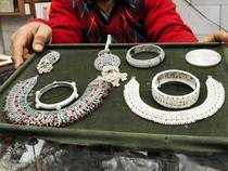 Amid a weakening trend overseas, silver prices dropped by Rs 308 to Rs 38,401 per kg in futures trade as speculators cut down their bets at prevailing levels.