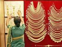 Gold prices retreated from a 21-month high by plunging Rs 600 to Rs 29,050 per ten grams at the bullion market today on weak cues from overseas markets amid fall in demand from jewellers at existing levels.