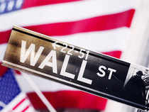 Wall Street gained on Tuesday, extending a rally from Friday, as investors snapped up beaten-down consumer discretionary, industrial and financial stocks.