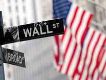 Wall St ended higher after employment data allayed investors' concerns about a sluggish economy without bolstering fears of an imminent rate hike.