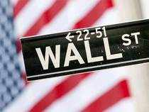 Wall Street was lower on Thursday morning, ahead of the long Easter weekend, as a stronger dollar weighed on crude oil.