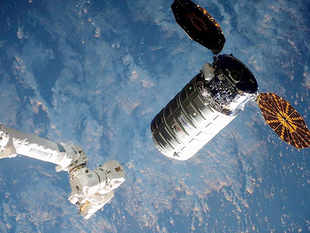 The Cygnus cargo ship nears the robotic arm at the International Space Station.