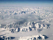 Greenland's lithosphere has hot depths which originate in its distant geological past and cause the island's ice to rapidly flow and melt from below.