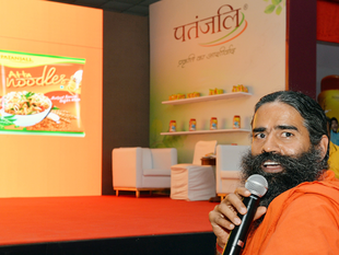 Patanjali claims its annual revenues has crossed Rs 5,000 crore, narrowing its gap with consumer product companies such as Dabur, Marico and Godrej Consumer.