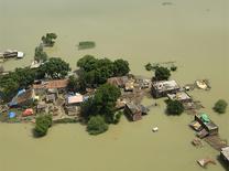 Houses marooned in floods