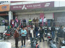 I-T raids Axis Bank in Noida, over Rs 60 crore found
