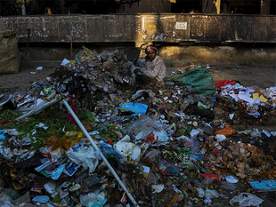 """A bench, headed by NGT Chairperson Justice Swatanter Kumar, pulled up Delhi government and the municipal corporations over the garbage mess in the city and observed that """"public was suffering due to tussle between government and Corporation""""."""