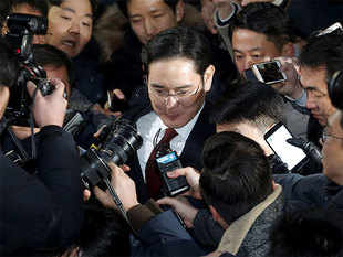 "The tall, bespectacled 48-year old did not look visibly affected by the session, in which he was questioned by two prosecutors, including one nicknamed the ""Chaebol Sniper""."