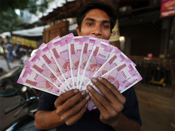 Rupee opens 8 paise higher at 66.75 against dollar