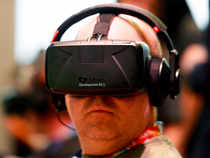 Attendee tries Oculus Rift Development Kit 2 headset at Electronic Entertainment Expo in Los Angeles.