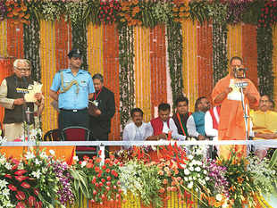 Governor Ram Naik administering oath of office and secrecy to Uttar Pradesh chief minister Yogi Adityanath in Lucknow on Sunday. Prime Minister Narendra Modi is also seen