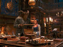 This image released by Disney shows Dan Stevens as The Beast, left, and Emma Watson as Belle in a live-action adaptation of the animated classic 'Beauty and the Beast.'